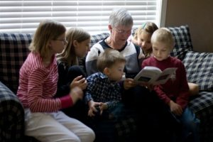 Oma Reading to Grandchildren